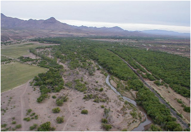 Aerial view of the Santa Cruz River facing northwest over the northern portion of Rio Rico (background: Tumacácori Mountains).