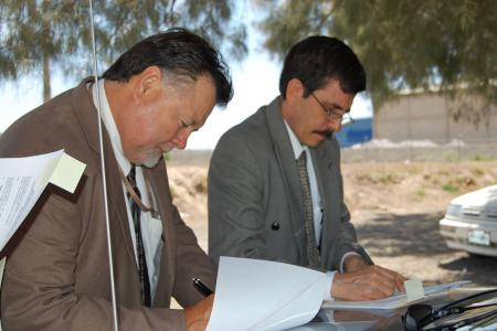 Signing Ceremony at Boundary Monument #1 in El Paso/Juarez. Principal Engineers John Merino and Luis Antonio Rascón Mendoza. August 19, 2009